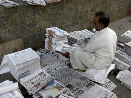 current events: KARACHIPAKISTAN_NEWSPAPPER DISTRIBUTOR ARRANGING  NEWSPAPER AT NEWS DISTRIBUTOR POINT A NEWSPAPER IS A SCHEDULED PUBLICATION CONTAINING NEWS OF CURRENT EVENTS. HERE ON THURSDAY 4 OCTOBER 2012