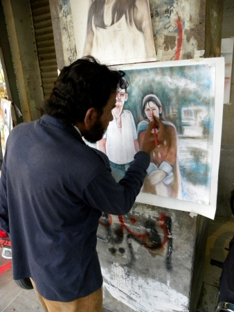 KarachiPakistan_Pakistani Artist Skecteching Beautiful Paintins Pictures. Here On Wednessday 14  November 2012 in Karachi  Editorial