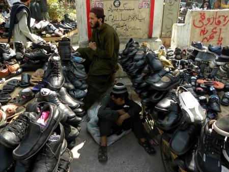 KARACHIPAKISTAN, SALESMEN OF FOOTWEAR HERE MONDAY 28 JANUARY 2013                      Editorial