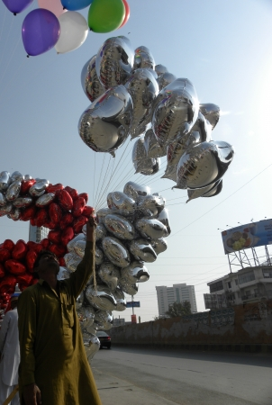 upcoming: Karachi, Pakistan : PAKISTANI VENDOR SELLS HEART SHAPED BALLOONS FOR UPCOMING VALENTINE