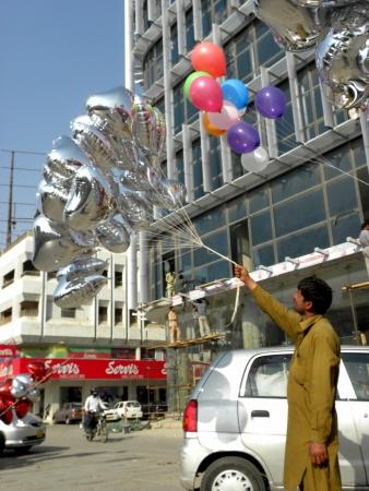 Karachi, Pakistan : PAKISTANI VENDOR SELLS HEART SHAPED BALLOONS FOR UPCOMING VALENTINE