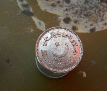 KARACHIPAKISTAN_PAKISTANI CURRENCY COINS HERE ON SATURDAY 16 MARCH 2013