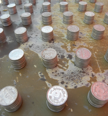 KARACHIPAKISTAN_STACK OF PAKISTANI CURRENCY COINS HERE ON SATURDAY 16 MARCH 2013