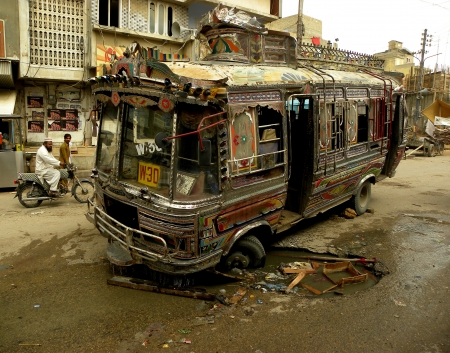 KARACHIPAKISTAN_LOCAL PASSENGER BUS GOT STUCK IN HOLE  ON A ROAD IN MEHMOODABAD KARACHI HERE ON TUESDAY 9 APRIL 2013
