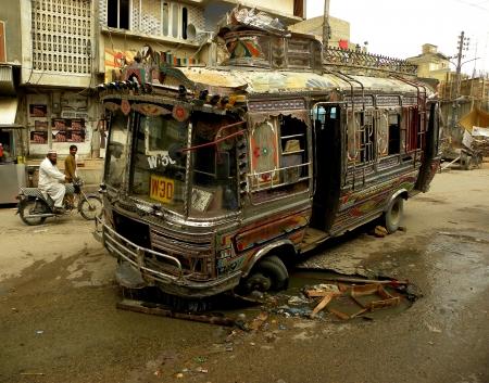 KARACHIPAKISTAN_LOCAL PASSENGER BUS GOT STUCK IN HOLE  ON A ROAD IN MEHMOODABAD KARACHI HERE ON TUESDAY 9 APRIL 2013