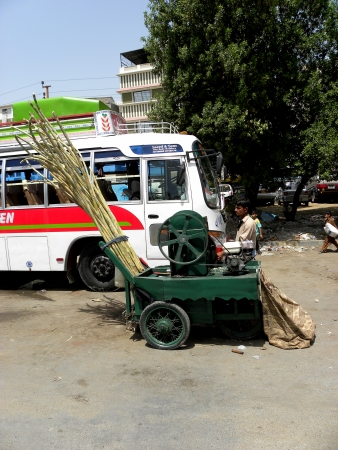 KARACHIPAKISTAN_SUGARCANE JUICE VENDOR SELL DIFFERENT  TYPE OF FRUIT JUICES OVER A CART  CART  AND MOSTLY  IT FOUND IN THE MOJOR CITYS OF PAKISTAN LIKEWISE KARACHI,LAHORE,PESHSAWAR, ESPECIALLY PEOPLE DRINK THIS BEVERAGE IN SUMMERS TIME HERE ON SATURDAY Editorial