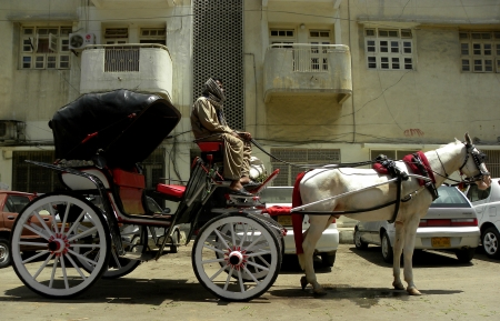 KARACHIPAKISTAN_TAANGABAGGI ARE VERY POPULAR RIDE TRANSPORTATION USED FOR PAKISTAN,INDIA,BANGLADESH ITS FUN TO RIDE INAND ALSO CHEAPER TO HIRE THAN TAXI  OR RICKSHAW HERE ON MONDAY 15 APRIAL 2013                                Editorial