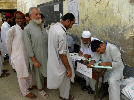local election: ELECTION OFFICERS PREPARES VOTERS INFORMATION BEFORE CAST HIS VOTE AT POLLING STATION IN LOCAL  GOVERNMENT SCHOOL IN KARACHI PAKISTAN TODAY ON SATURDAY 11 MAY 2013