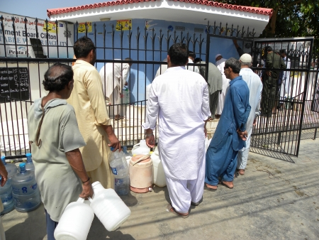 gallons: PEOLPE STANDS IN QUEUE FOR FILLING DRINKING WATER IN BOTTLES GALLONS THROUGH CANTONMENT BOARD CLIFTON KARACHI IT HAS BEEN REPORTED THAT SOME OF ARES IN KARACHI HAVE PROABLEM IN WATER SUPPLYINGHERE ON MONDAY 13 MAY 2013   Editorial