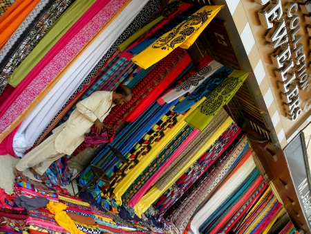 VENDOR SALES COLOUR FULL FABRICS COLLECTION, DISPLAY STALLS AT ROAD SIDES OF KARACHI STREETS HERE ON SUNDAY 19 MAY 2013