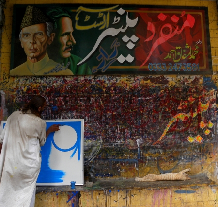 karachi: KARACHI:PAKISTAN_MATURE PAINTER BUSY IN HIS PAINTING ON BORAD, NEAR BANS ROAD KARACHI HERE ON THURSDAY 23 MAY 2013                                    Editorial
