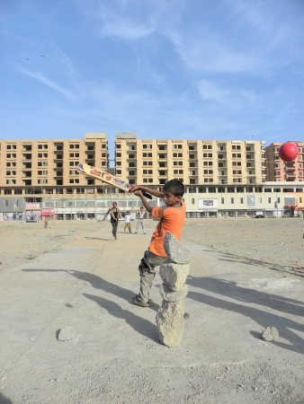 KARACHIPAKISTAN_YOUNG BOYS PLAYING CRICKET IN A OPEN GROUND, WHILE THEY JUST MADE WICKET THROUGHT (BROKEN CONCRETE BLOCKS) TO CONTIUNE THE MATCH HERE ON MONDAY 10 JUNE 2013