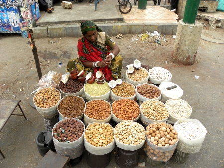 KARACHIPAKISTAN_PAKISTANI HARD WORKING WOMANS WORKING AS SALEWOMAN ON THEIR BUSINESS,SALE DRY FRUITS IN KARACHI FAMOUS MARKET (IMPRESS MARKET)WORKING TO SUPPORT THRIT FAMILIES HERE ON TUESDAY 9 JULY 2013