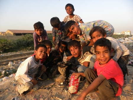 A GROUP OF YOUNG CHILDREN  ENJOYING CAMERA IN FROUND OF THEM                                Editorial