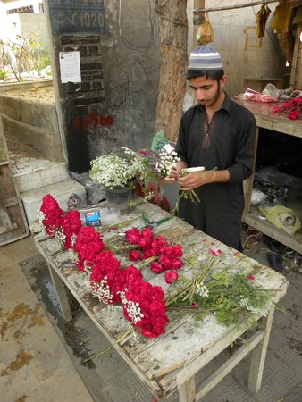 KARACHI PAKISTAN_YOUNG BOY MAKING FRESH FLOWER OF BOUQET ON VALENTINES DAY HERE ON FRIDAY 14 FEBRUARY 2014