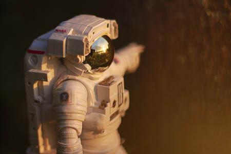 Astronaut viewing a sunrise Sajtókép