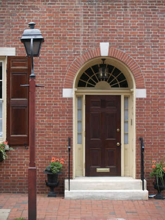 sidelight: Classic arched doorway in a brick victorian