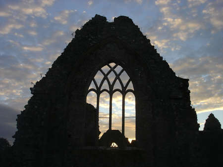 Sunset through the ruins of Athenry Abbey in County Galway, Ireland photo
