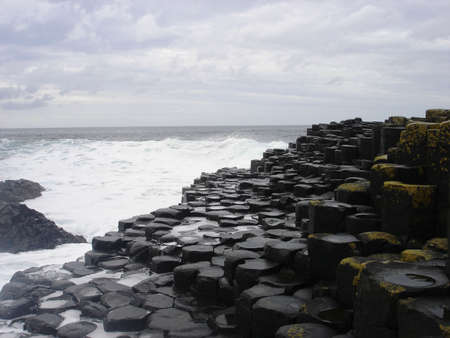 northern ireland: The ocean crashes against the basalt rocks of the Giants Causeway in Northern Ireland