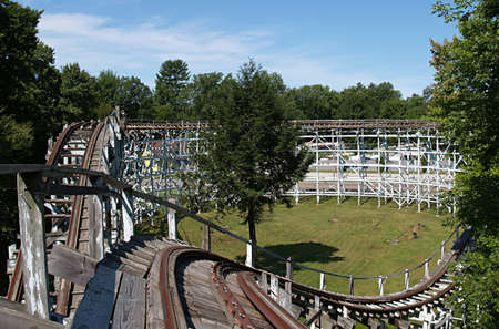 Old abandoned wooden roller coaster at an amusement park photo