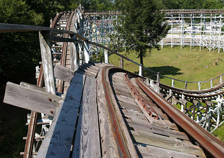 roller: Old abandoned wooden roller coaster at an amusement park
