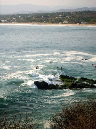 oaxaca: Surfers at Puerto Escondido, Oaxaca. Stock Photo