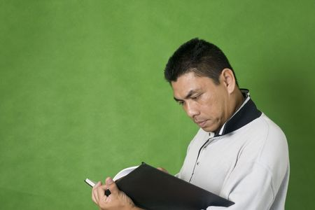 Man writing something on a book photo