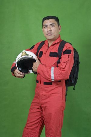 Portrait of man firefighter isolated on green photo