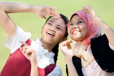 Two lovely girl looking cheerful photo