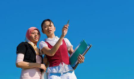 Two muslim student looking something interesting  photo