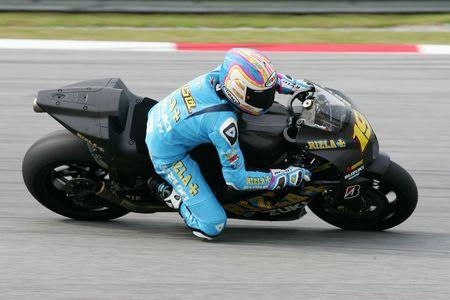SEPANG, MALAYSIA - FEB. 26 : Rizla Suzuki MotoGP rider Alvaro Bautista of Spain takes a corner during the 2010 pre-season test at Sepang circuit February 26, 2010 in Sepang, Malaysia.