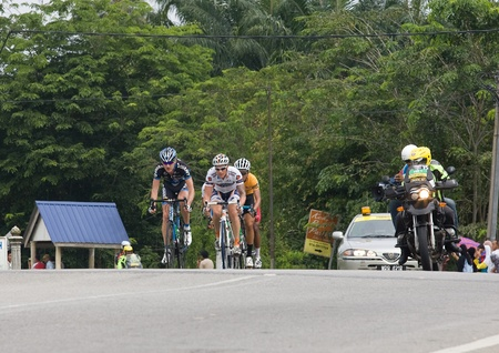 BANTING, SELANGOR - JANUARY 29 : The first group of riders during Stage 7  Tour de Langkawi from Banting to Tampin on January 29, 2011 in Banting, Malaysia.