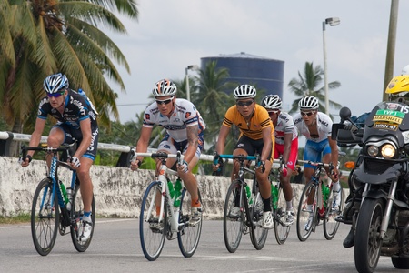 BANTING, SELANGOR - JANUARY 29 : The first group of five riders during Stage 7  Tour de Langkawi from Banting to Tampin on January 29, 2011 in Banting, Malaysia.