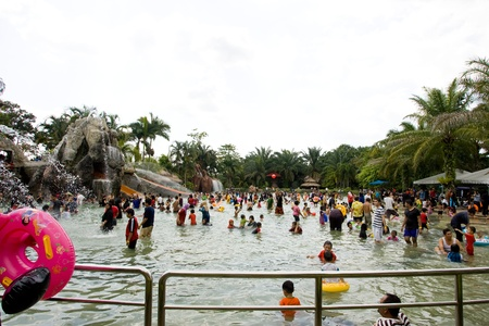 SUNGKAI, PERAK - FEBRUARY 5 : Locals take advantage of outdoor activities with family during Chinese New Year holiday in the water theme parks, Felda Sungai Kelah on February 5, 2011 in Sungkai, Malaysia.