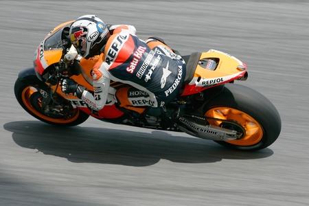 SEPANG, MALAYSIA - FEB. 23 : Repsol Honda Team rider Dani Pedrosa of Spain accelerated after takes a corner during the 2011 pre-season test 2 at Sepang circuit February 23, 2011 in Sepang, Malaysia. Stock Photo - 8944935
