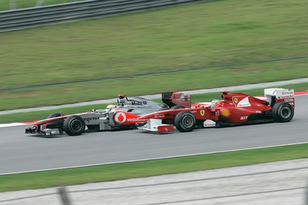 SEPANG, MALAYSIA - APRIL 10: Fernando Alonso and Lewis Hamilton compete with each other at PETRONAS Malaysia Grand Prix on April 10, 2011 in Sepang, Malaysia. An estimated 100,000 people were watching. Editorial