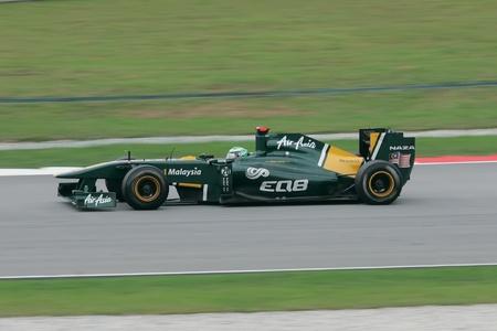 SEPANG, MALAYSIA - APRIL 10: Finnish Heikki Kovalainen of Team Lotus accelarate during at Petronas Formula 1 Grand Prix on April 10, 2011 in Sepang, Malaysia. An estimated 100,000 people were watching.