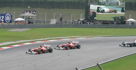 SEPANG, MALAYSIA - APRIL 10: Felipe Massa and Fernando Alonso of Ferrari Team during race day at PETRONAS Malaysia Grand Prix on April 10, 2011 in Sepang, Malaysia.