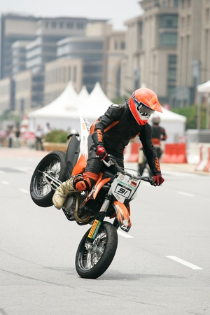 PUTRAJAYA, MALAYSIA - APRIL 2: Unidentified rider of supermotard in action during F1 street demonstration on April 2, 2011 in Putrajaya, Malaysia. The event is a promotion for F1 Malaysia Grand Prix 2011.