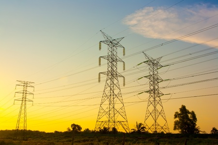 Electricity pylons at sunset Stock Photo - 9715770
