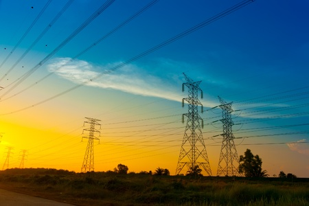 Electricity pylons at sunset Stock Photo - 9715769