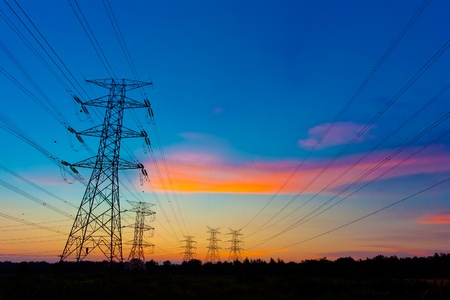 Electricity pylons at sunset Stock Photo - 9715768