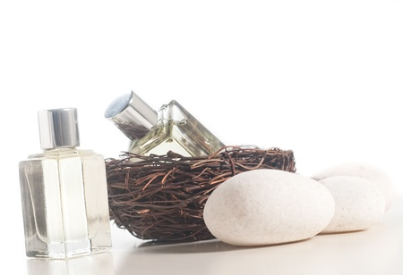 Spa concept - Perfume bottle in the bird nest photo