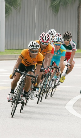 PUTRAJAYA, MALAYSIA - FEB 18: Unidentified cyclists from Malaysia team in Elite Mens Road Race (179.2km) at the 32nd Asian & 19th Junior Asian Cycling Championships on Feb 18, 2012 in Putrajaya, Malaysia.