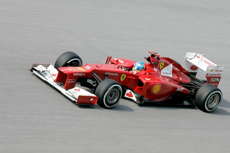 SEPANG - March 23: Fernando Alonso of Scuderia Ferrari Team accelerate during Friday practice at Petronas F1 GP on March 23, 2012 in Sepang, Malaysia. The race will be held on Sunday March 25, 2012. Editorial