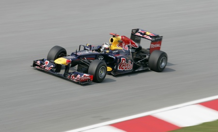 SEPANG - March 23: Sebastian Vettel of Red Bull Racing Team accelerate during Friday practice at Petronas F1 GP on March 23, 2012 in Sepang, Malaysia. The race will be held on Sunday March 25, 2012.