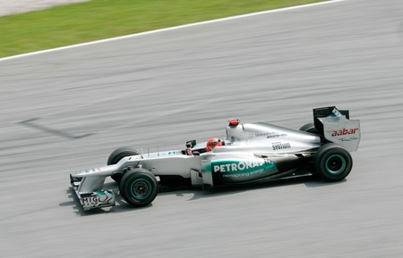 michael schumacher: SEPANG, MALAYSIA - March 23: Michael Schumacher of Mercedes AMG Petronas F1 take a corner at PETRONAS Malaysian Grand Prix on March 23, 2012 in Sepang, Malaysia. The race will be held on Sunday March 25, 2012.