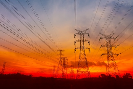metal pole: Electricity pylons in sunset background