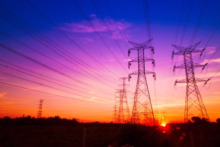 Electricity pylons at sunset photo