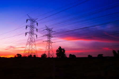 power supply: Dramatic sunset at electricity pylons Stock Photo